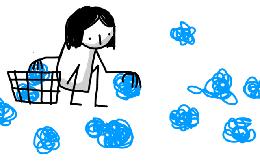 女の子が青いボールを拾ってカゴにいれている